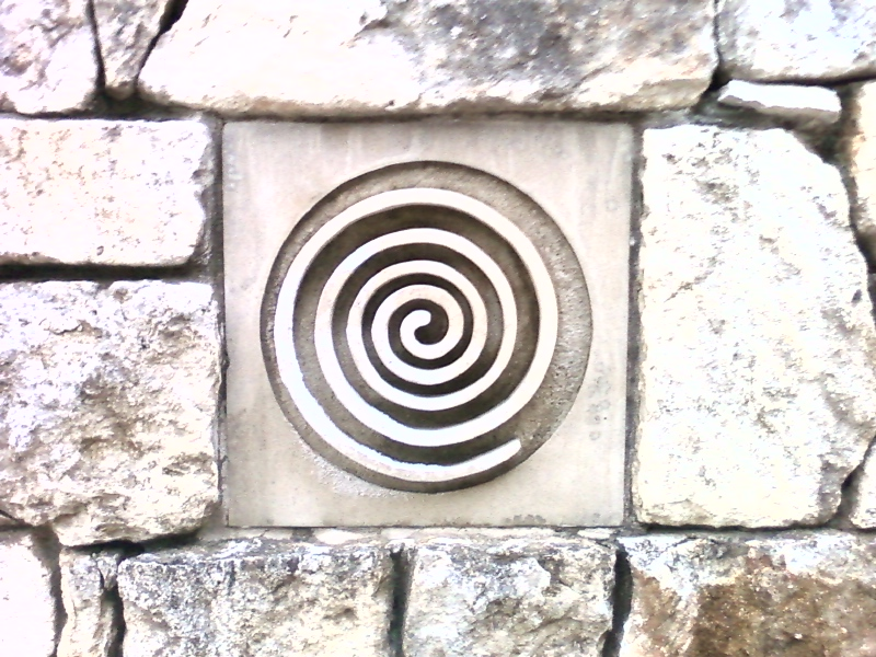 A stone spiral set into a wall in Austin, TX. Keisha took the photo herself.