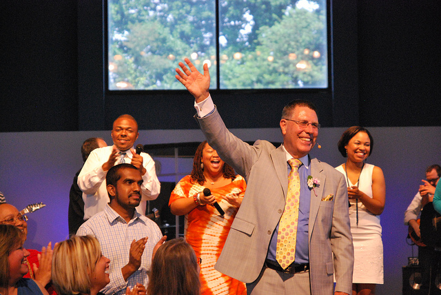 J. David Newman waves goodbye to a smiling, applauding congregation in Fulton MD, July 2012