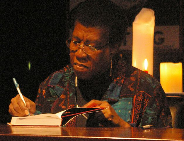 Octavia Estelle Butler signing a copy of Fledgling after speaking and answering questions from the audience. The event was part of a promotional tour for the book.