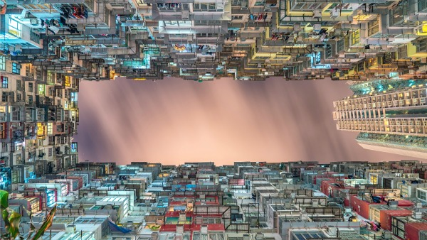 Photo: Steven Wei, Hong Kong: a view of tightly spaced apartment high-rises from the ground up.