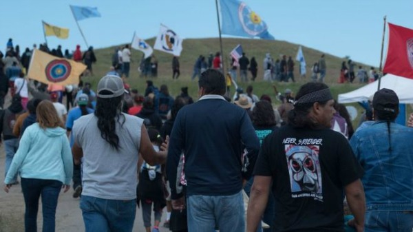 Native protesters walk toward construction of the Dakota Access pipeline. C. Northcutt took this photo.
