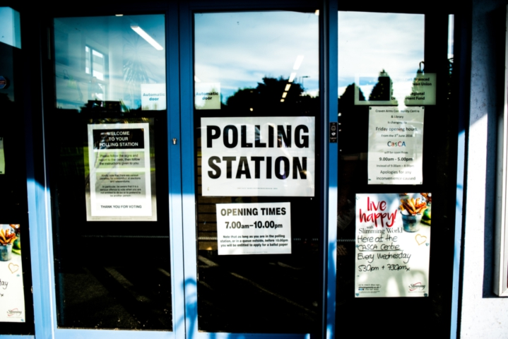 Close-up of polling station signs.