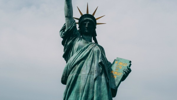 Cropped photo of the Statue of Liberty. The flame is not visible but the tablet is.