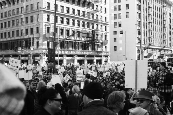 Black and white picture of people protesting.