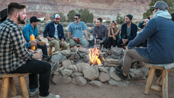 Bros around a campfire at the Grand Canyon.